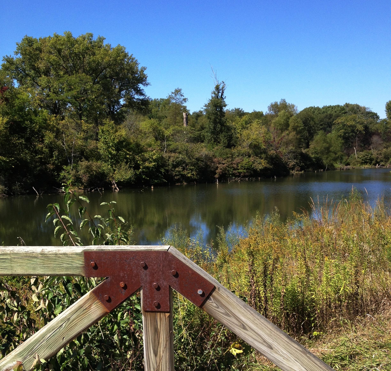 Crossing a little bridge on a trail in F.W. Kent Park in Iowa